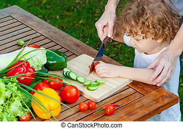 mother teaches son knife cut cucumber - mother teaches son...