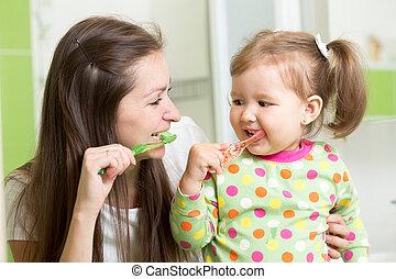 mother teaching child teeth brushing - mother teaching...