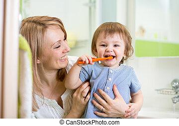 mother teaching child teeth brushing - mother teaching son...