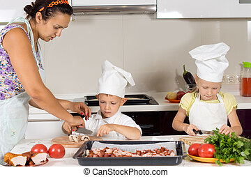 Mother teaching her children to cook