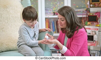 Mother Teaching son Sanitary Prevention Measures - Mother ...