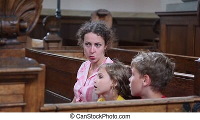 Mother tell about religion for kids when they sit in church