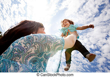 Mother Throwing Daughter into Sky