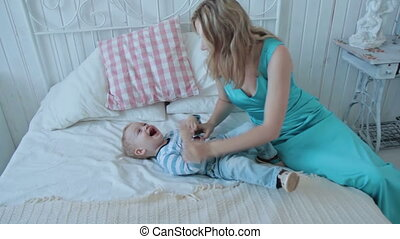 Mother tickling her cute son