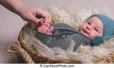 Mother touching newborn's baby - Mother's hand touching her...