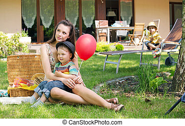 Mother, two kids and the balloon
