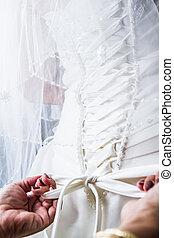 Mother Tying the Bride's Wedding dress