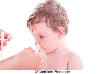 Mother using baby nasal aspirator.