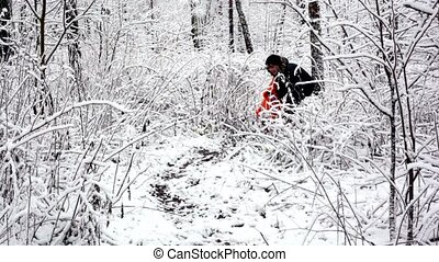 Mother walk with her kid in bush on woods where all covered with snow