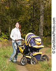 mother walking with pram