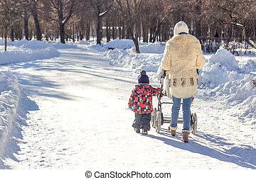Mother walks with children