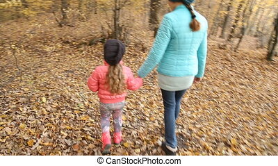 Mother walks with the child