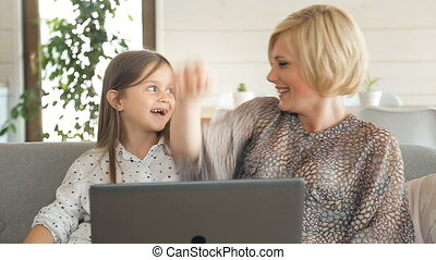 Mother Watch Cartoon with Daughter - Caring mother watching...