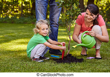 Mother watering a tree