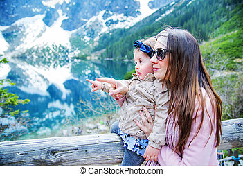 Mother with a baby on family summer vacation