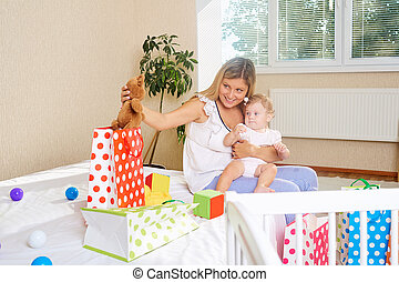 Mother with a child with presents and packages.