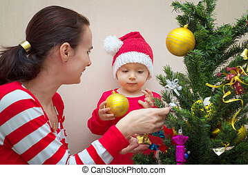 Mother with baby and Christmas tree