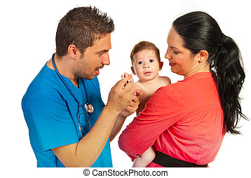 Mother with baby at doctor