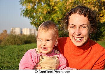mother with baby. autumn