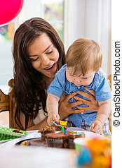 Mother With Baby Boy Eating Cupcake