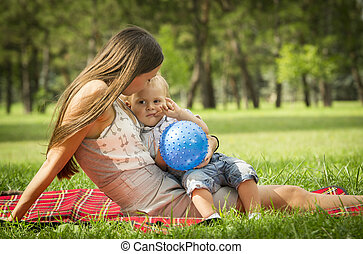 Mother with baby boy in park