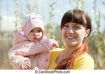 mother with baby girl in spring