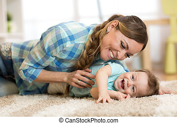 Mother with baby having a fun at home