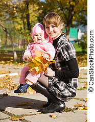 mother with baby in autumn