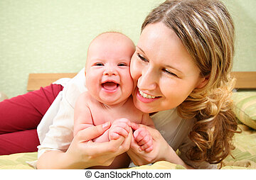 mother with baby in bed 2