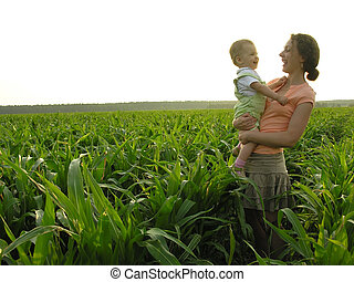 mother with baby in field
