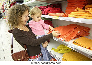mother with baby in shop