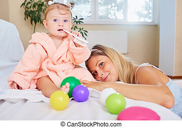 Mother with baby in the room.