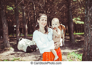 mother with baby in the woods