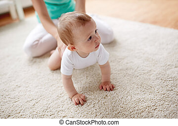 mother with baby on floor at home - family, child and...