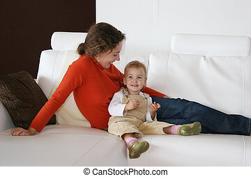 mother with baby on sofa