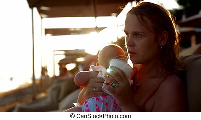 Mother with baby on summer vacation at the seaside