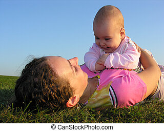 mother with baby on sunse