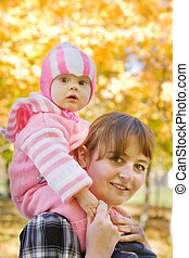 mother with  baby outdoor in autumn