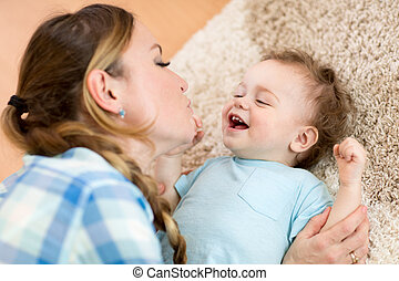 Mother with baby playing together at home
