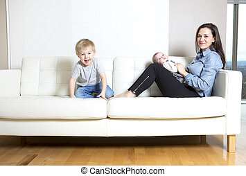 Mother with baby sofa