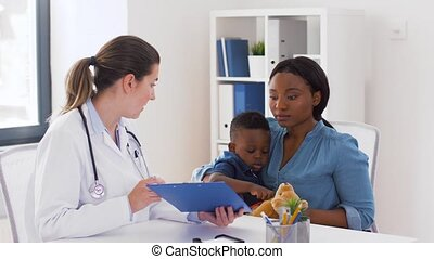 mother with baby son and doctor at clinic - medicine,...