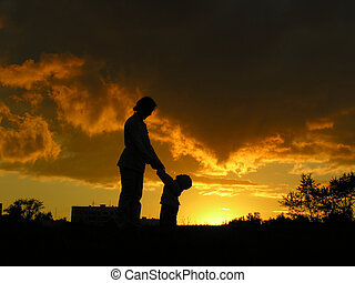 mother with baby sunset