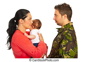 Mother with baby talk with military dad - Mother holding...