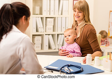 Mother with baby visit pediatrician for check-up - Young...