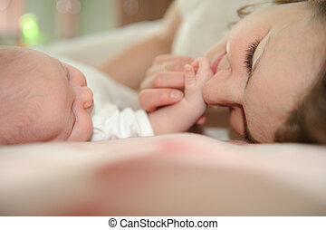 Mother with baby - Young mother lying with her little baby