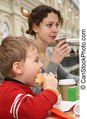 mother with boy in cafe