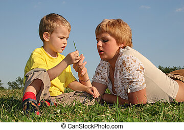mother with boy on meadow