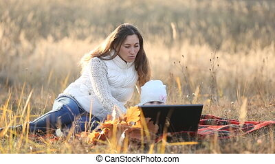 mother with child and laptop