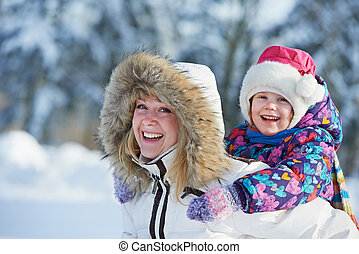 Mother with child at winter