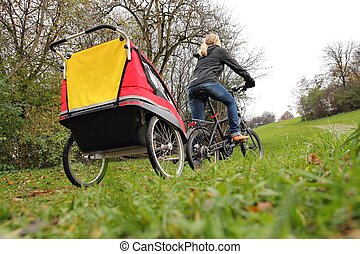 Mother with child bike trailer